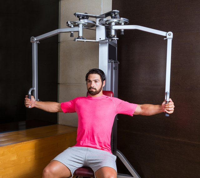A pec fly machine with handles emphasizes your upper chest more.