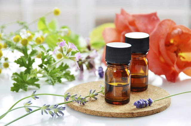 Two bottles of essential oils blended with flower extracts.