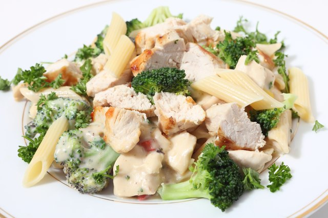 Grilled chicken with penne pasta, broccoli and garlic sauce