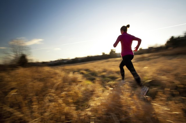 Woman running on open space trail