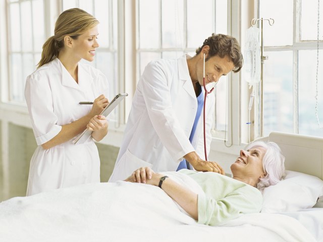 Doctor examines patient in hospital