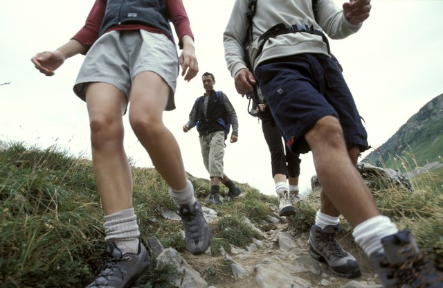 Outdoor activities such as hiking will improve the look of your calves over time.