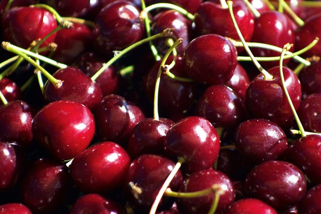 A crate of red cherries.