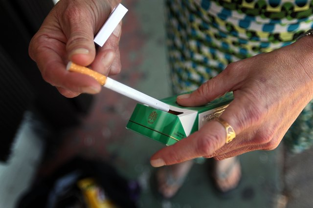 Woman taking a menthol cigarette out of the pack