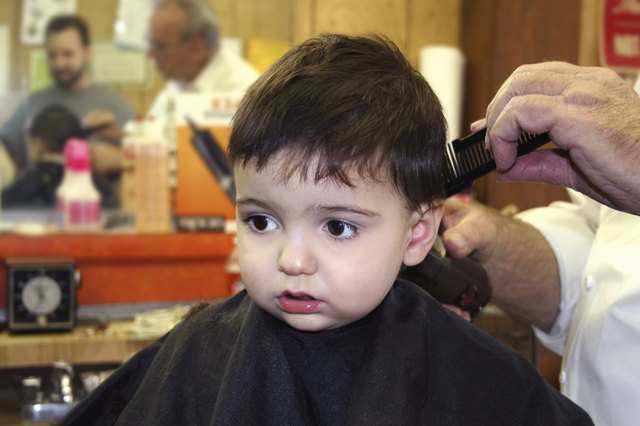 toddler getting hair trimmed