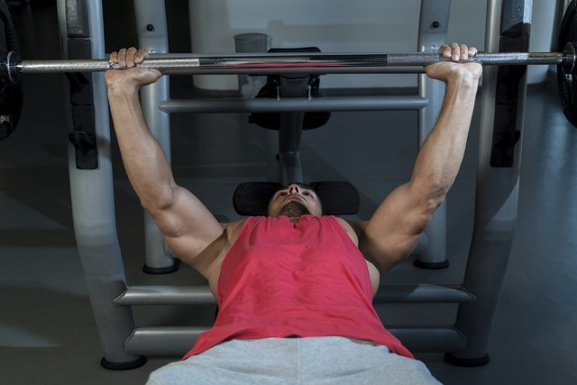 Things like your ability level will influence your bench press more than arm length.