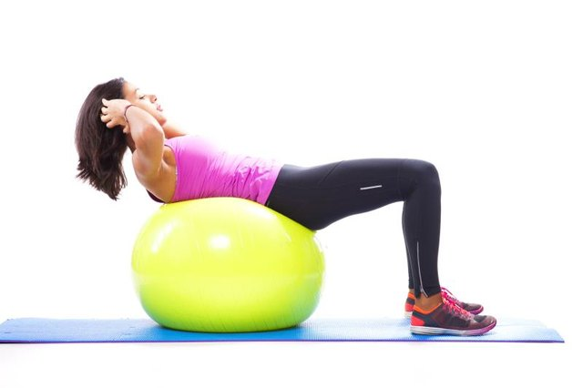 Use a stability ball to change up your sit-up routine.