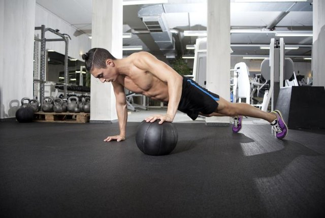A medicine ball accentuates your plyometric push-ups.