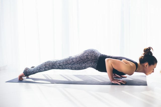Chaturanga challenges your upper body much like a classic push-up.