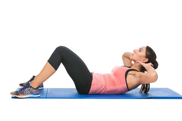 Proper form is essential to building up to a higher number of sit-ups.