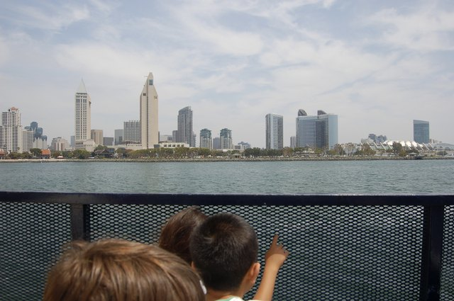 Children travel on a ferry to the city.