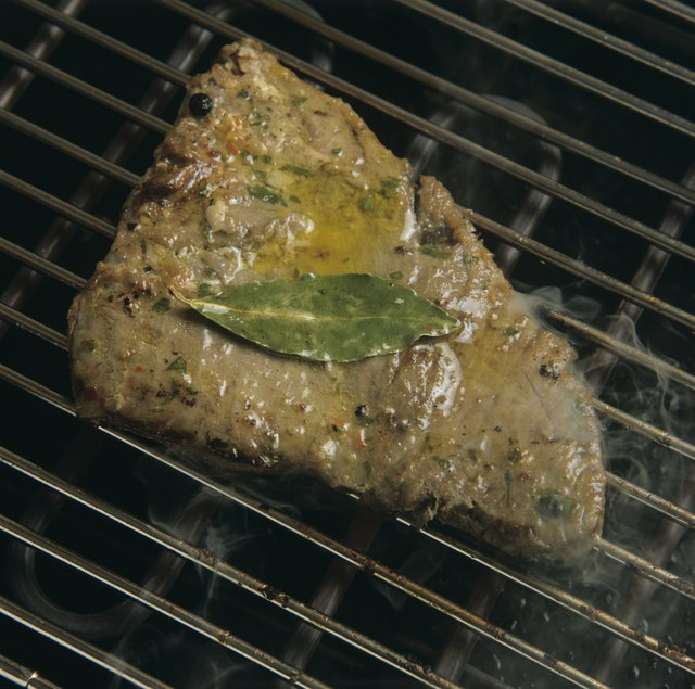 Marinated tuna on a grill.