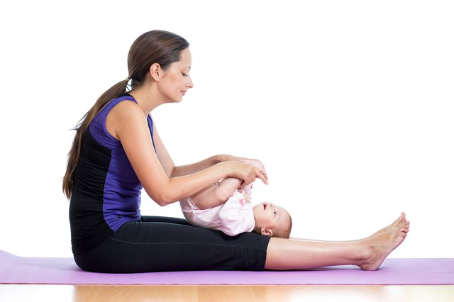 Gently encourage your baby to move into simple poses.