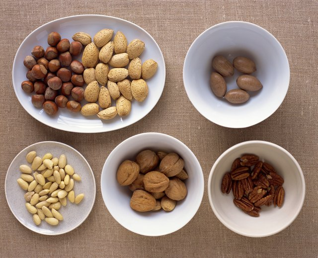 Aerial view of nuts in bowls.