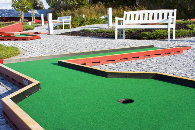 A close-up of a green on a miniature golf course.