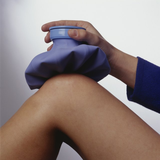 A woman with an ice pack on her knee