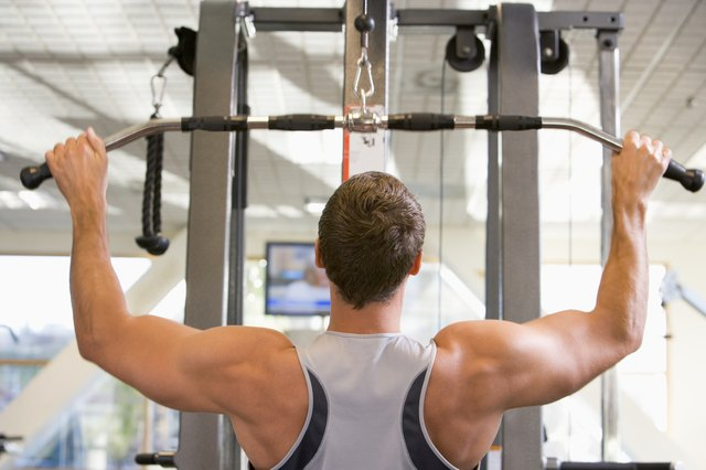 FInd the lat pulldown machine as part of a cable station.