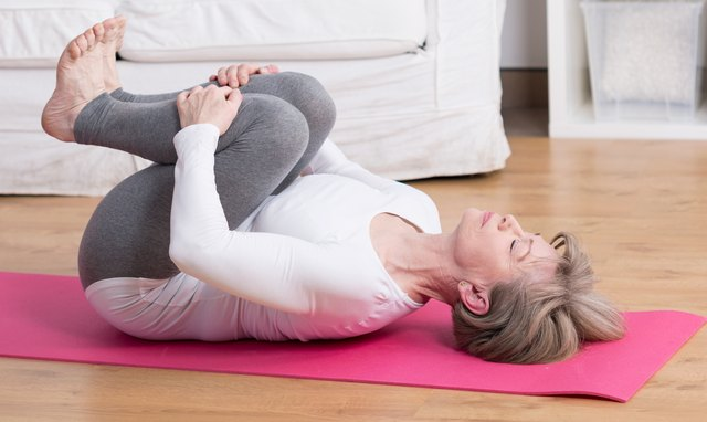 Gentle bringing your knees to your chest brings your low back into flexion and stretches the muscles.