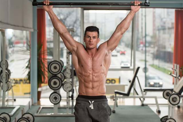 Keep your core engaged throughout pull-ups to work your abs.