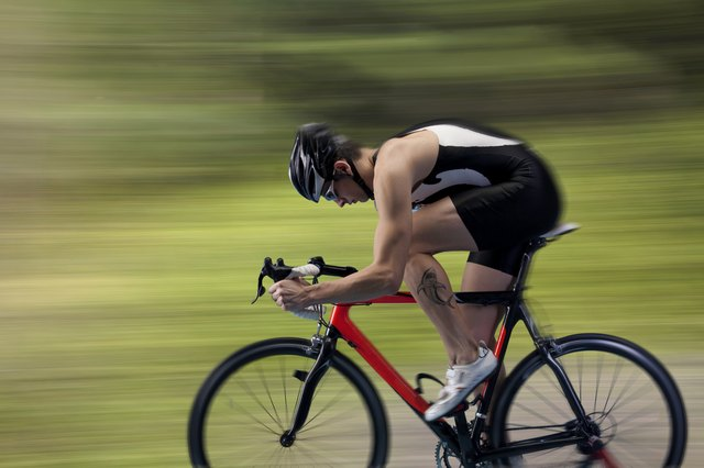 Cyclist gaining speed during workout