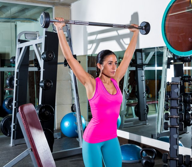 A shoulder press may also be done with a wide grip.
