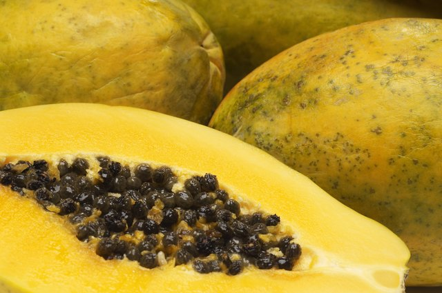 The inside of papaya skin can be used to exfoliate rough areas of skin.