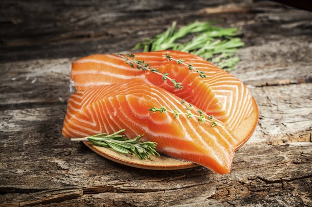 Serve fresh salmon with lots of vegetables.
