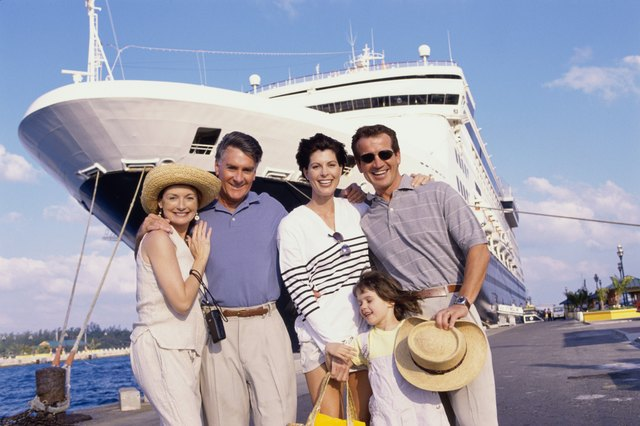 Family in front of cruise boat