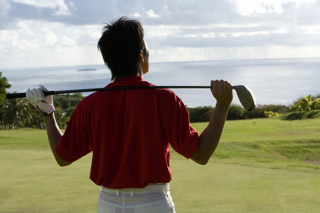 Household items such as a golf club can be used for shoulder motion exercises.