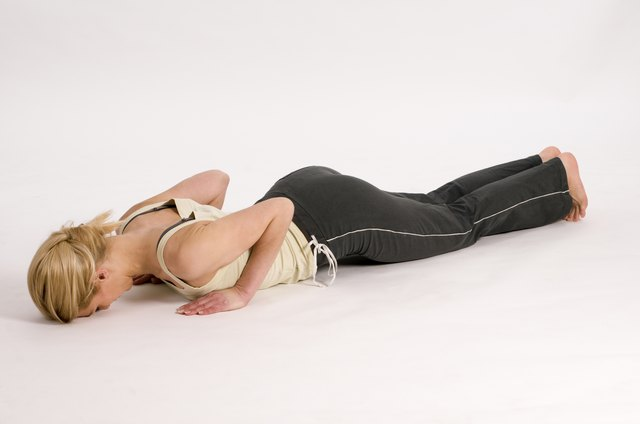 Prone W's are performed by lying on your stomach and lifting your arms in the air.