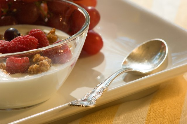 Yogurt often contains probiotics that keep your digestive system healthy and decrease stomach bloating.