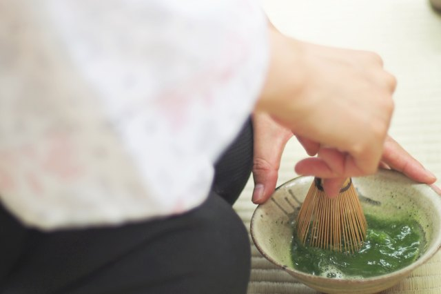 Use a bamboo chasen to whisk the fine powder into hot water.
