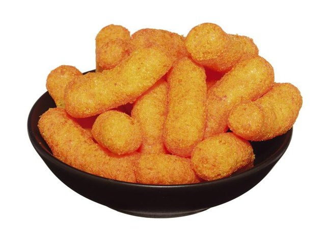 Bright-yellow cheese puffs contain artificial colors and flavors.