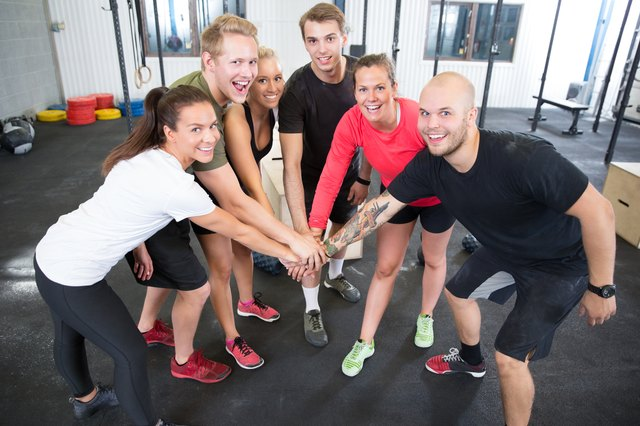 Work out with a group in CrossFit.