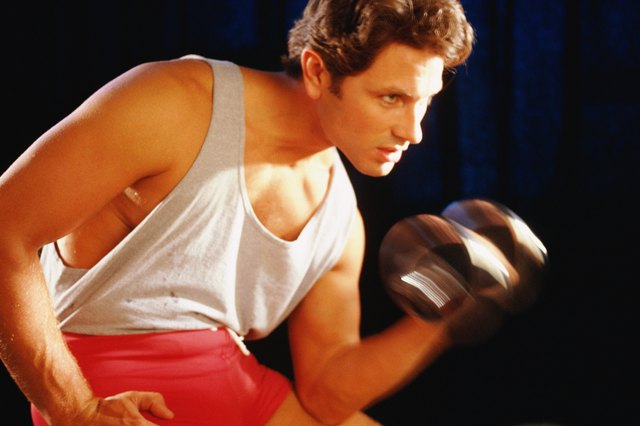Strength-training exercises such as these arm curls will help reduce fat in the arms.
