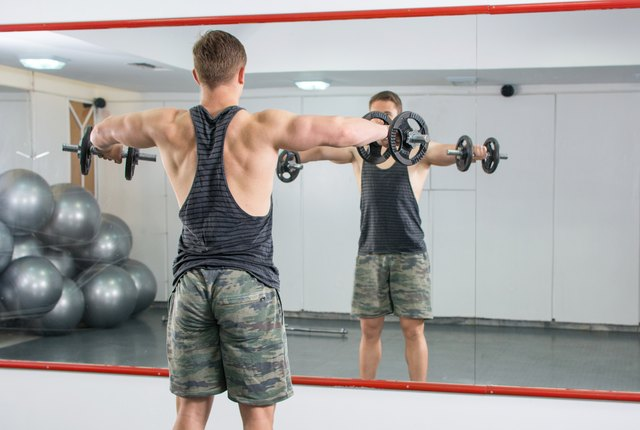 As your strength improves, you can progress to standing lateral raises.