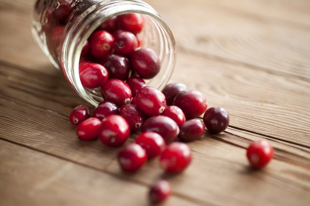 Cranberries spilling onto table