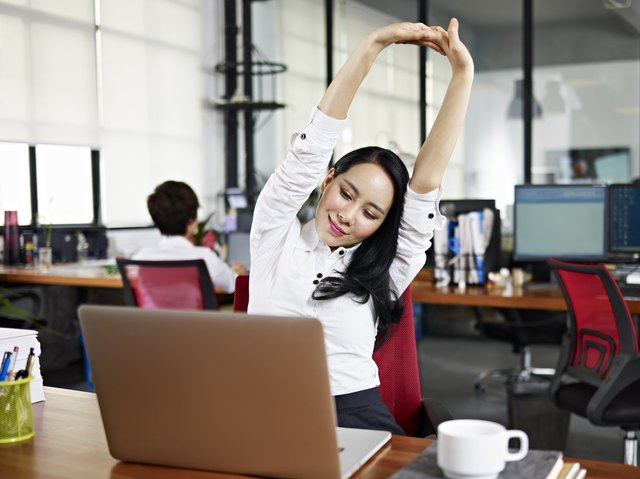Perform stretches during the workday without even leaving your desk.