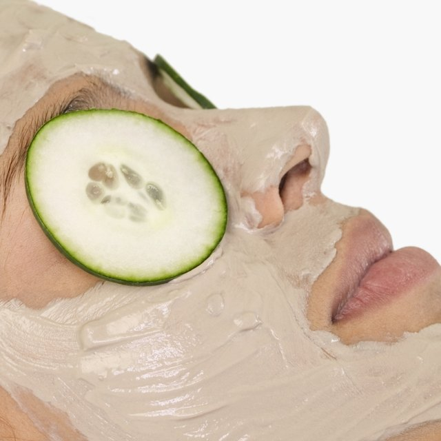 Place cucumber slices over eyes.
