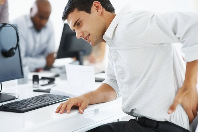 Businessman having back pain at work