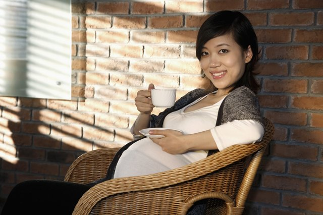 Pregnant woman with cup in her hand