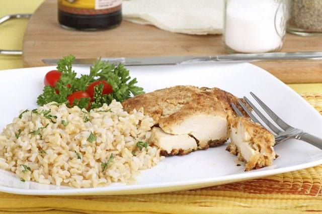Breaded chicken with brown rice and small salad