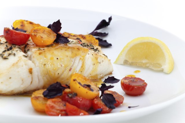 Pan fried halibut with tomatoes.