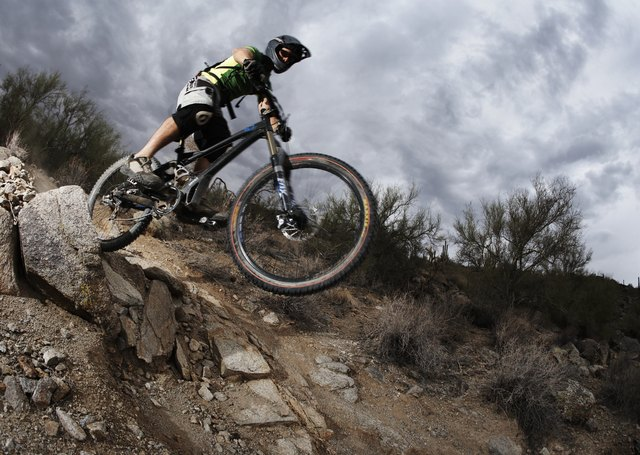 Mountain biking is strenuous because of off-road trails and hills.
