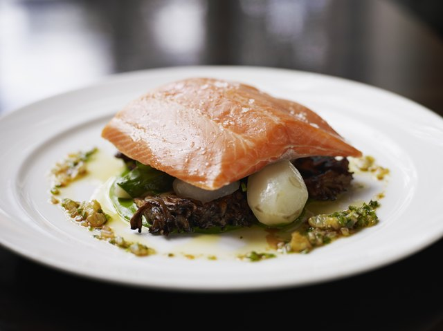Steelhead trout with sunchokes and maitake mushrooms. Fish is an excellent choice for a high-protein meal.