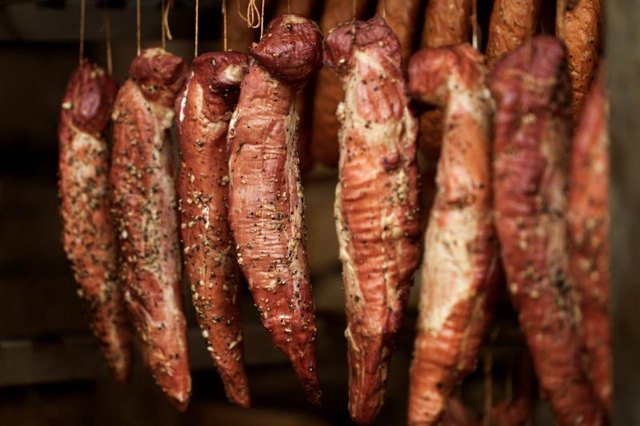 Ham and bacon are in a smoke house. Photo Credit BlueHorse_pl/iStock ...