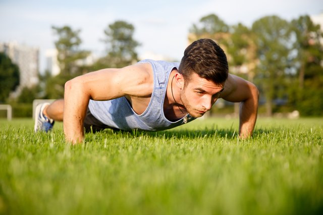 Keep your torso level to the ground during the push-up.