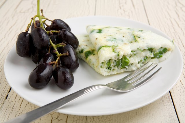 egg white spinach omelette with fruit on plate