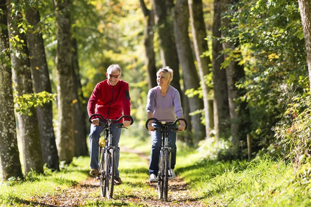 Senior couple exercising on bike