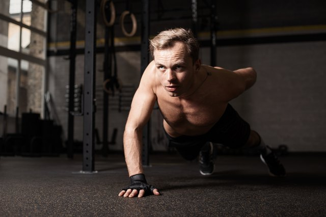 The one-arm push-up works muscles in your upper and lower body.
